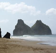 Just one of the beautiful beaches with jagged cliffs on the island of Fernando de Noronha, Brazil