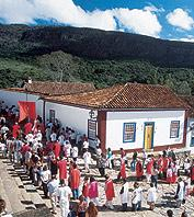 A colorful festival occuring on the white-washed streets of Tiradentes, Brazil